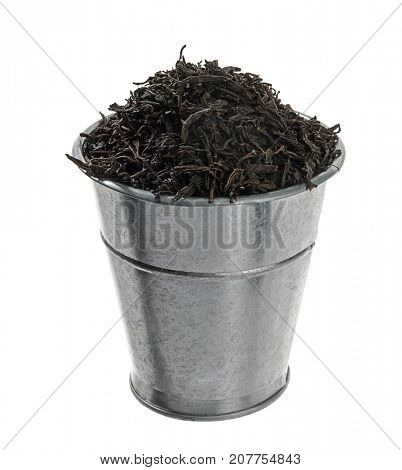 Ceylon tea in metal zinc bucket isolated on white background.