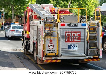 Adelaide Australia - November 14 2015: Metropolitan Emergency fire truck and police car on duty in Adelaide CBD during public event