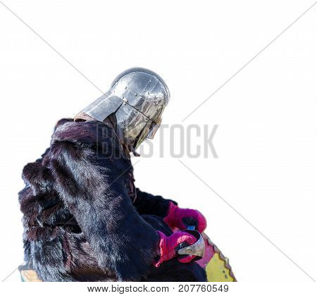 medieval knight in a fur Cape wearily sad after the battle on white background