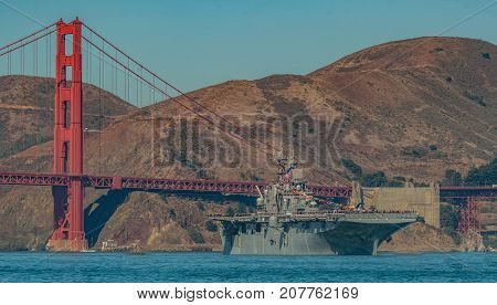 USS Essex aircraft carrier and SF fire Boat coming through the Golden Gate Bridge in the bay for fleet week on Oct,6 2017 in San Francisco Ca.