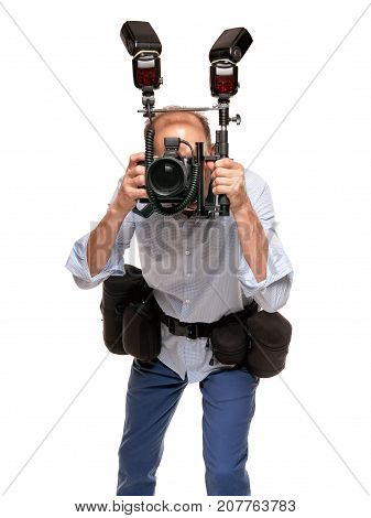 Portrait of handsome young photographer with equipment ready for photoshoot