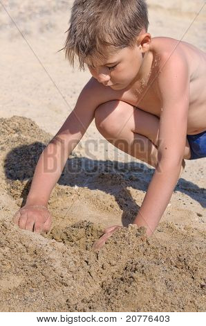 Sea, A Boy Playing In The Sand