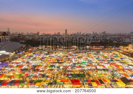 Top view city downtown flea market with sunset over business area background