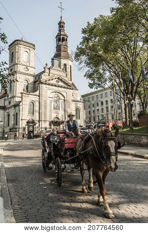 Quebec City Canada 13.09.2017 - Touristic Horse carriage in front of Cathedral basilica of Notre-Dame de Quebec part of Old town UNESCO world heritage