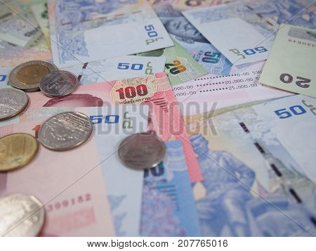 Earning money on saving account book with banknotes and coins background, finance status per month concept