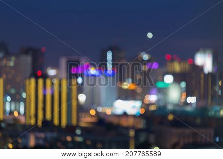 Night blue twilight sky blurred bokeh light office downtown abstract background