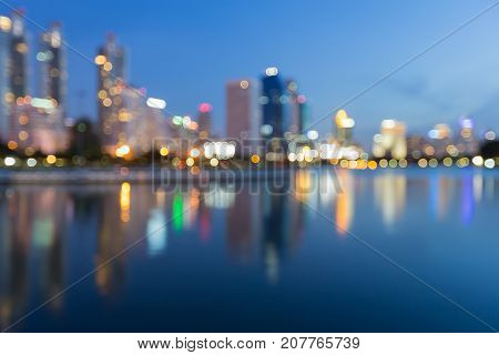 Blurred blue light office building with water reflection abstract background