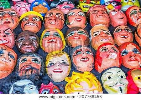 Cuenca Ecuador - Dec 30 2014: A tienda (market) selling polital and fun masks for an upcoming fiesta (New Year's Eve)