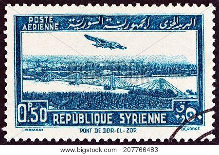 SYRIA - CIRCA 1940: A stamp printed in Syria shows Deir ez-Zor bridge, circa 1940.