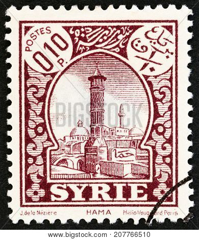 SYRIA - CIRCA 1930: A stamp printed in Syria shows Hama, circa 1930.