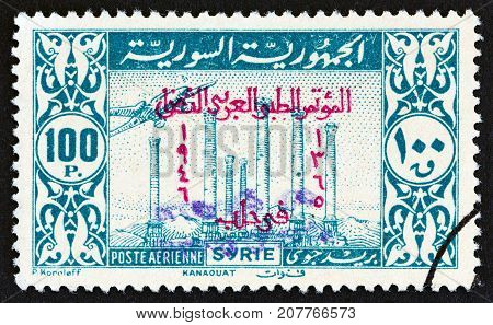 SYRIA - CIRCA 1946: A stamp printed in Syria shows Temple ruins, Kanaouat, circa 1946.
