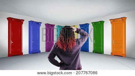 Woman standing in hallway in front of multicolored doors. Concept of hard choice and opportunities.