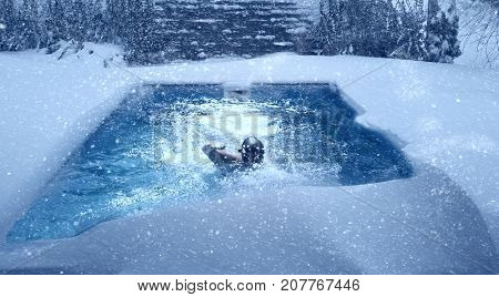 Swimming in pool during winter. Imege of surreal