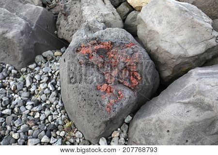 Red Volcanic Stones At The Ocean