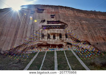 Temple Matisi in Gansu province in China and the hunging prayer flags in the foreground.