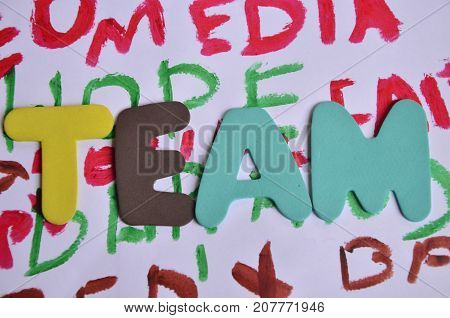 the word team on a  abstract colored background