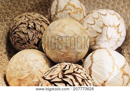 Home Decor Close Up of Ornamental Decorative Balls in A Woven Wickers Basket Used for Decorating.