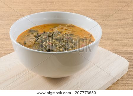 Thai Cuisine and Food Delicious Thai Spicy Coconut Milk Cream Based Curry with Cassia Leaves and Grilled Beef Fillet.