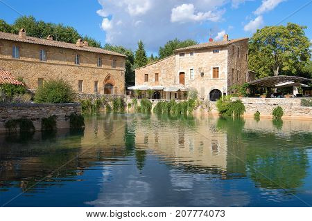A sunny day by the ancient thermal pool in Bagno Vignoni. Tuscany, Italy