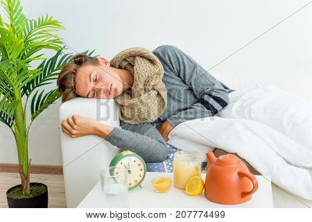 A portrait of an ill guy having flu at home