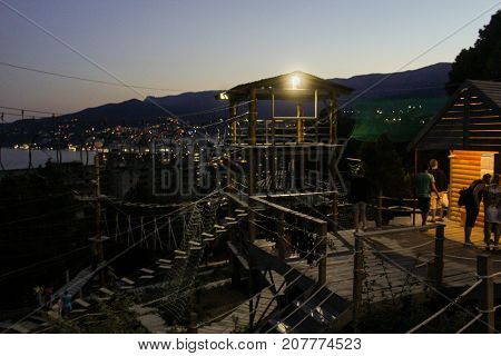 Yalta, Crimea - 11 July, Evening cable car entertainment, 11 July, 2017. Night surroundings and adjoining territories of hotel Yalta Intourist.