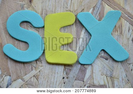 the word se4x on a  a abstract colored background