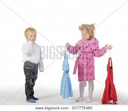 wife in curlers choose clothes to wear and husband trying to help. Children parody