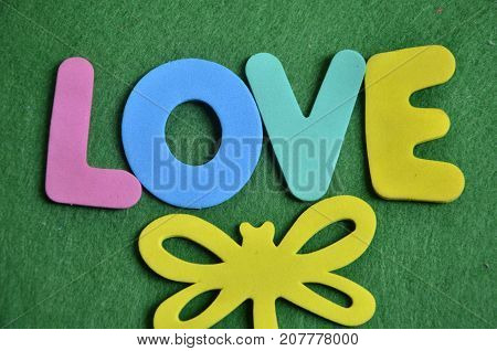 the word love on a  abstract green background