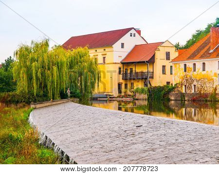 Old mill reflected in the water, Putim, Southern Bohemia, Czech Republic.