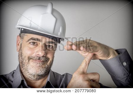 Construction worker makes a sign of downtime and rest