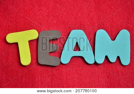 word team on a abstract red background