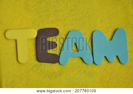 word team on a  abstract yellow background