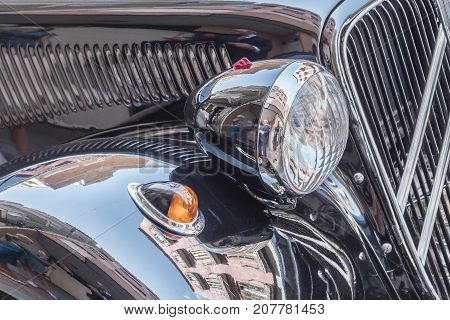 Headlight and intermittent detail in a classic black car
