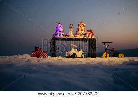 Happy Snowmen Ready To Celebrate Christmas In Mountains. Best Holiday In Mountains. New Year's Vacat