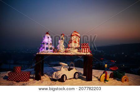 Snowmen Christmas Tree, Decoration Toys. Toys In Snow. Christmas Presents From Santa. Snowmen Wait F