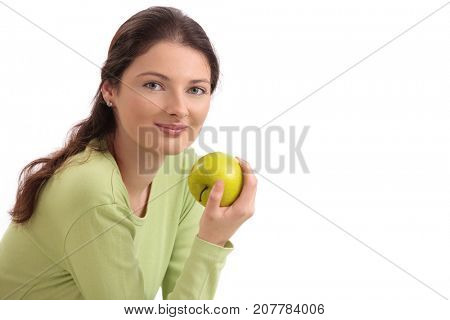 Healthy teenage girl eating apple, looking at camera, smiling. Isolated on white.