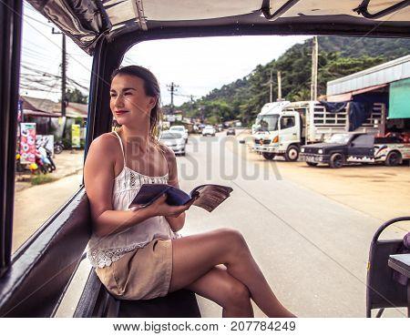 Girl Tourist In A Thai Tuk Tuk Taxi