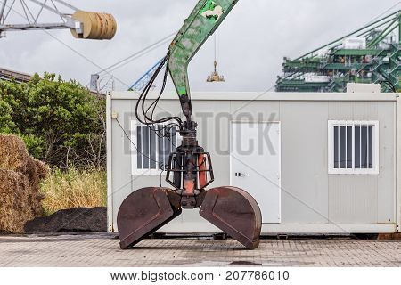 Bucket excavator in the old seaport for loading sand.
