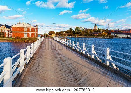 Scenic summer view of the wooden bridge on Suomenlinna Island, Helsinki, Finland