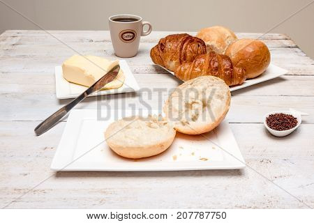 an Hard roll call it in Dutch Pistolee and croissant whit knife and butter