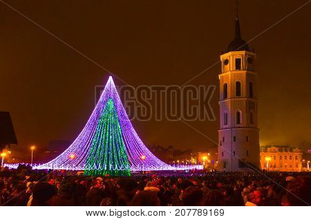 Vilnius, Lithuania - January 01, 2017: Unknown people going along street in old town, Vilnius at Lithuania at night on January 01, 2017