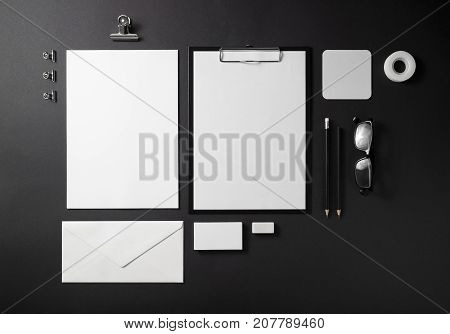 Photo of blank stationery set on black background. Corporate identity template. Responsive design mockup. Top view.