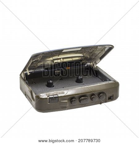 Old portable audio player or audio cassette tape isolated on white background. Retro handy cassette tape player.