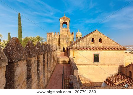 Tower of Homage and North wall of Alcazar de los Reyes Cristianos or Castle of the Christian Monarchs in the sunny day, Cordoba, Andalusia, Spain