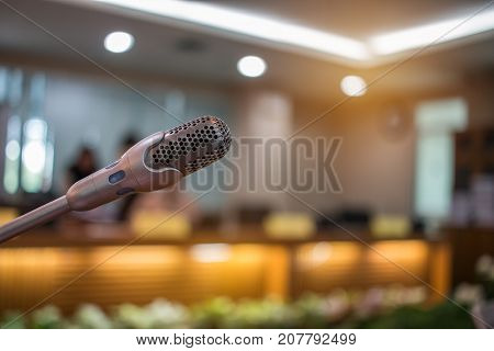 Blurred of Speaker mini mic Microphone in Conference room or seminar meeting hall in business event or academic classroom training in lecture class Concept of Speech and speaking.