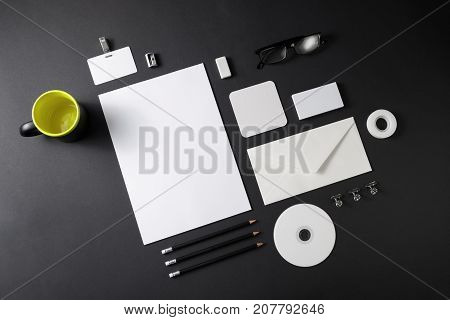 Corporate stationery template on black background. Blank stationery set. Responsive design mock up. Top view.