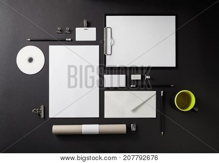 Blank stationery set on black background. Template for branding identity for designers. Top view.