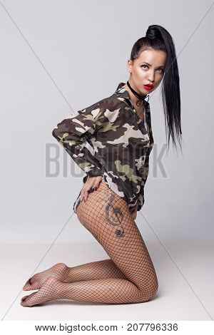 Beautiful Sexy Cheeky Girl In T-shirt And In Pantyhose With Red Lipstick On Lips And Tattoo On Leg I