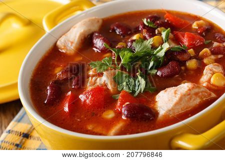 Traditional Chicken Chili Stew With Beans, Corn And Tomatoes Close Up. Horizontal