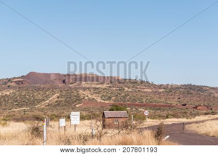 POSTMASBURG SOUTH AFRICA - JULY 7 2017: Entrance to the Morokwa manganese mine on the R386-road between Olifantshoek and Postmasburg in the Northern Cape Province of South Africa